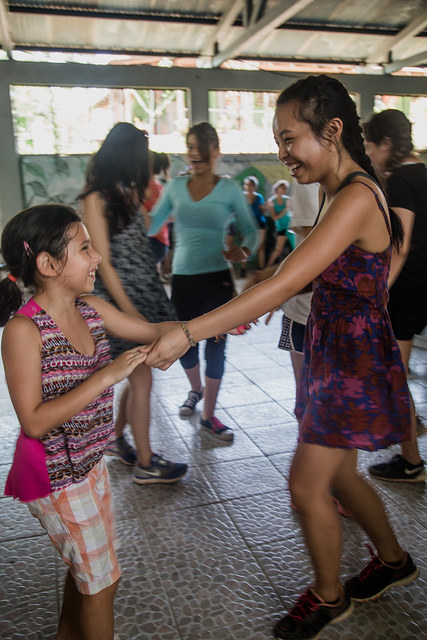 The author dances with local child.