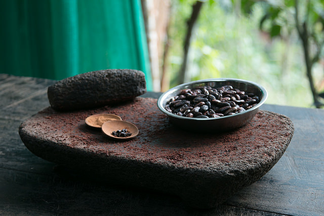 Cacao beans with grinding stones.