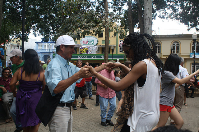 Kabria, attending pro-staff on the trip, dances with local man.