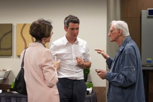 Dr. van Rooij discusses his research with members of the community
