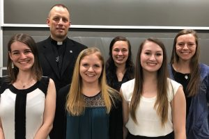 Sydne Jacoby, Victoria Targett, Madison Ward, Michelle McLaren, and Jen Bigoness with Fr. Dan Parrish