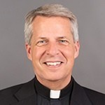 Father Mark Poorman, 20th president of the University