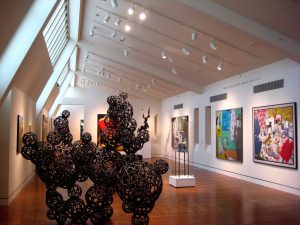 Several paintings and sculptures on display at the Portland Art Museum.