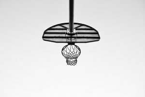 a basketball hoop seen from below and behind