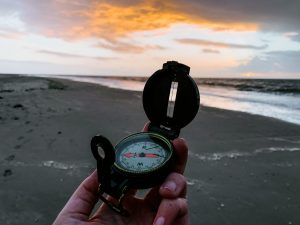 Compass on a beach