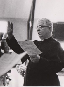 Fr. George Dum, C.S.C., directing choir, 1975 (click to enlarge photo)