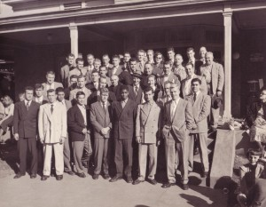The 1949 football team toured 20th Century Fox studios prior to the football game at Pepperdine. At center of photo in hat is Bing Crosby next to Rev. Theodore Mehling, C.S.C, university president, October 21, 1949