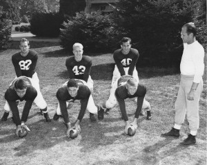 Six members of 1949 team with backfield coach Floyd Simmons