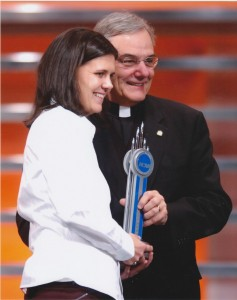 "Rev. E. William Beauchamp, C.S.C. with Christine Sinclair '06; in 2006 receiving the NCAA ""Top VIII"" Award 2006; top female collegiate soccer player 2006 (University Archives photo)"
