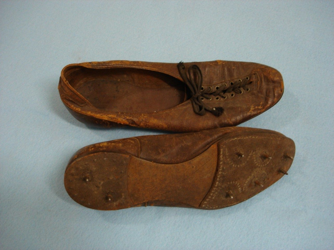 Track Shoes Worn by Eugene Schmitt, Columbia University Track Athlete, 1914-1915 (University Museum photo, click on image to enlarge)