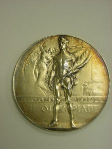 Olympic gold medal, Antwerp 1920, designed by Josue Dupon (from Wikimedia, click to enlarge)