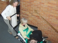 Drew Harrington, library director; and Caroline Mann, library evacuation chair training, 2008