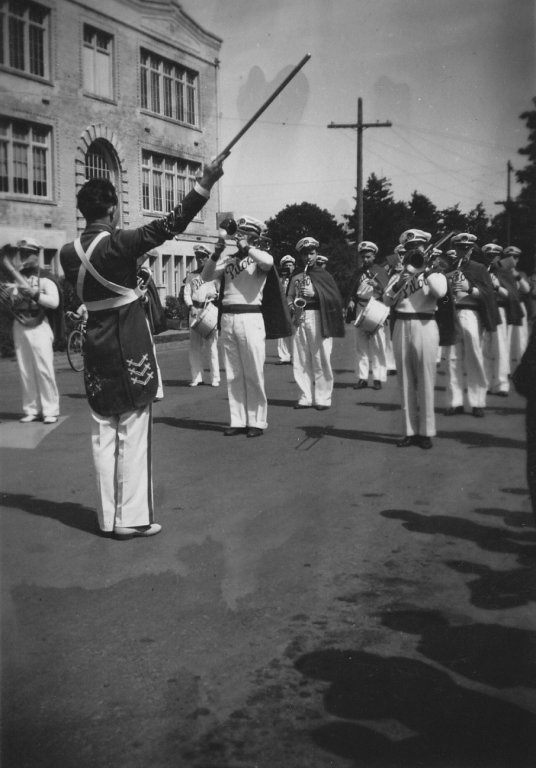 Portland Pilots Band practicing on street, ca1938