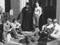 Fr. John Delaunay with Students in Front of Christie Hall
