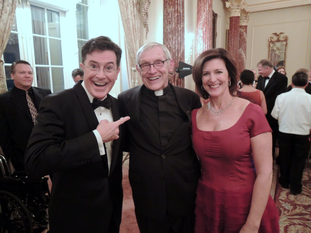 Stephen Colbert at Senate with Rev. Claude Pomerleau, December 2014