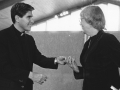 University President, Fr. Tom Oddo, C.S.C. presents Martha Wachsmuth with her 15 year pin, 1985