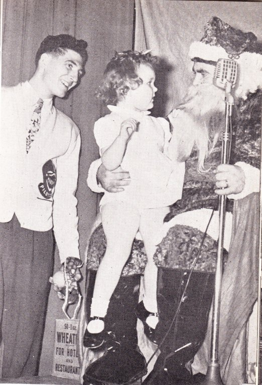 Intercollegiate Knight member with girl and Santa, 1950
