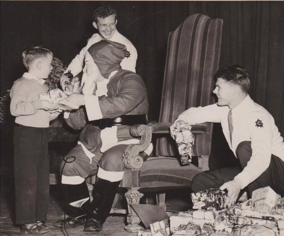 Young boy, Iota Kappa Pi members, and Santa, 1959