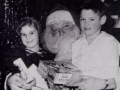 Two children with Santa Claus, 1956