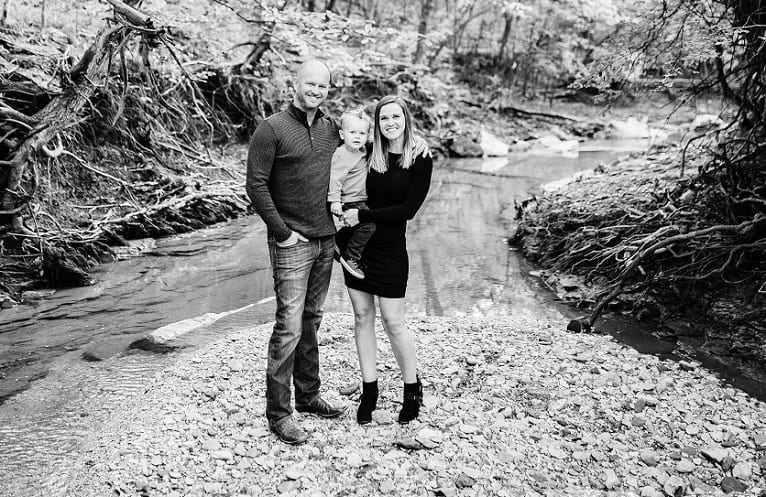 MBA Alumnus Ellison Jason Lindsey wife and child in front of a river 2018