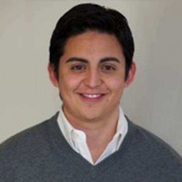 Smiling MBA alumnus Luis Ortiz