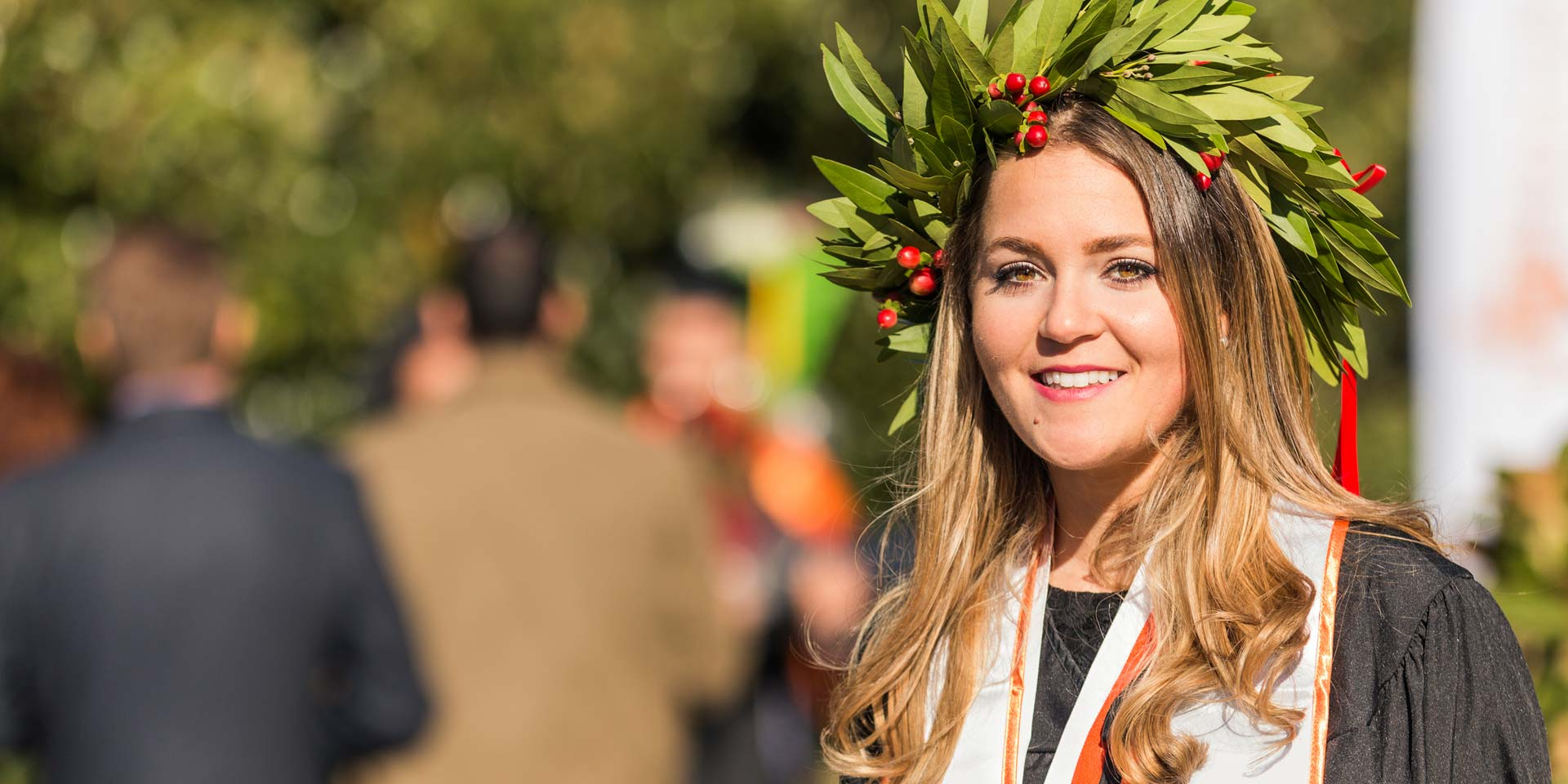 Marketing graduate Chiara Zamboni donned a headpiece with special meaning in her home country of Italy. The crown made of bay leaves and berries represents victory and success.