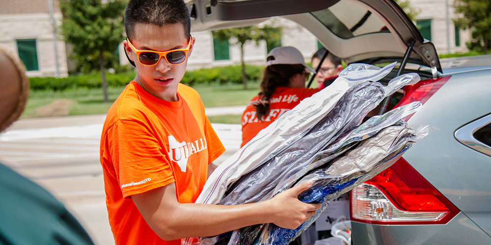 Jin Chen came to Move-In Day prepared to help new students settle into the dorms.