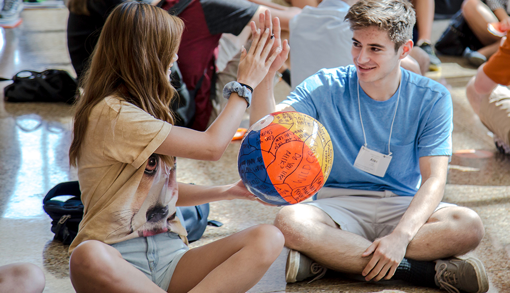 Jade Noland and Alex Prescott give each other high-fives during orientation small group exercises.