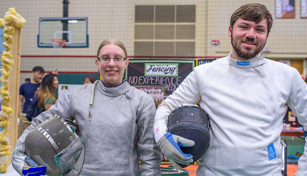 Emily Risinger and Conner Gray suited up to represent the Fencing Club at the student organization fair.