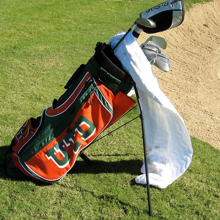 U-T-D golf bag and clubs near sandtrap