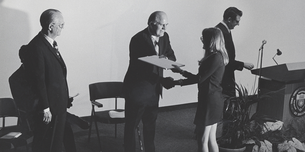 First UT Dallas President Dr. Bryce Jordan hands one of the first first UTD diplomas to Susan Seabury Mahlum MS'73