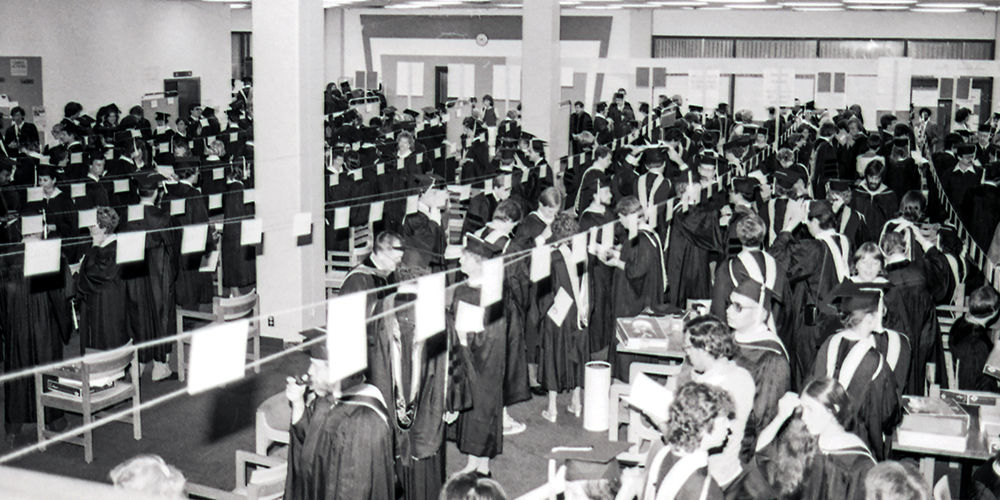 Graduates line up by name prior to an commencement ceremony