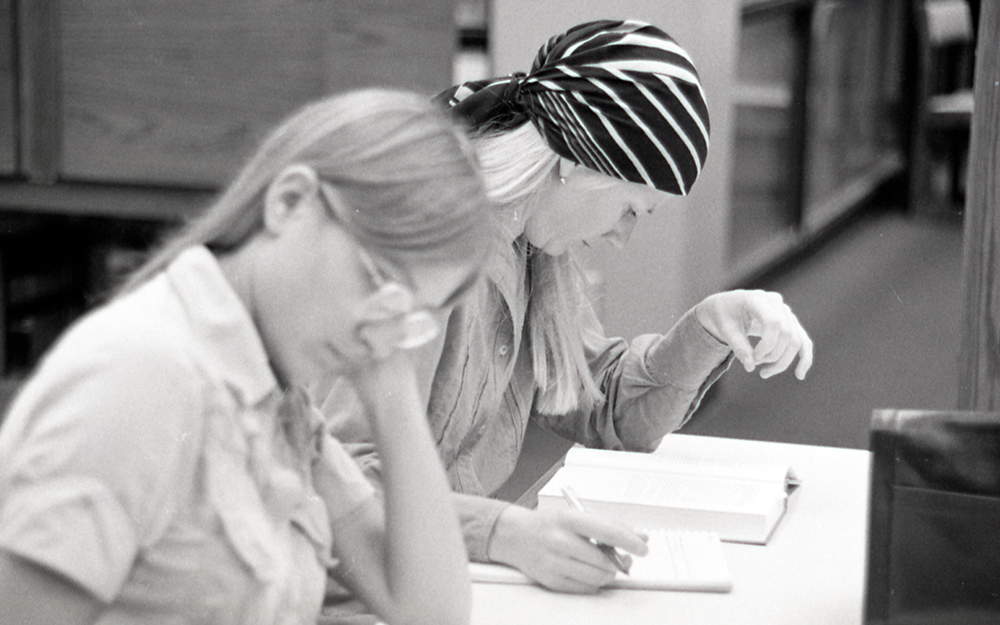 Two women studying in the library