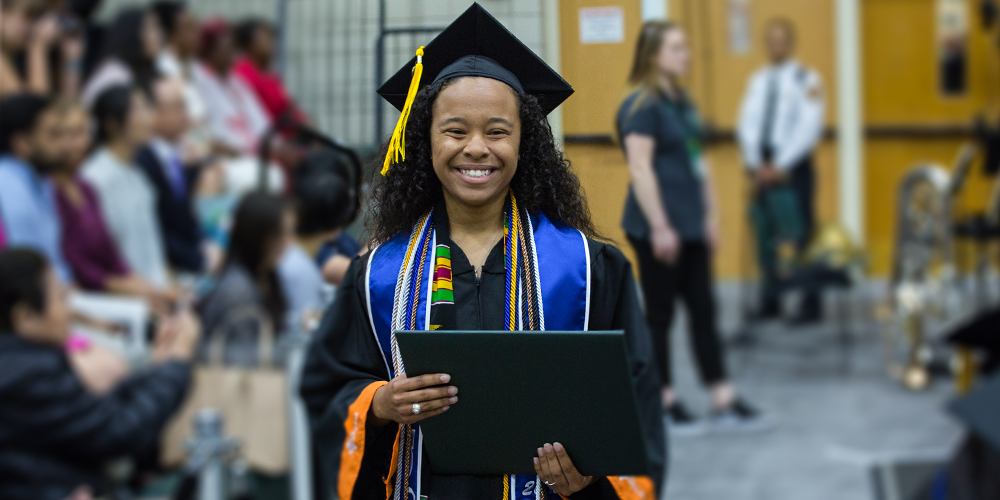 Kyontasia Wilson walks back to her seat after receiving her degree