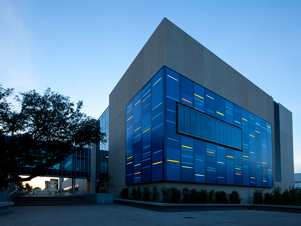 The Science Learning Center lit up at dusk