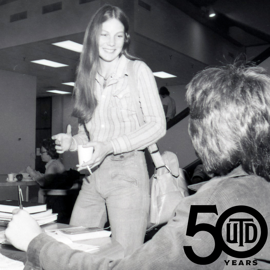 Old photo of students in McDermott Library cafeteria