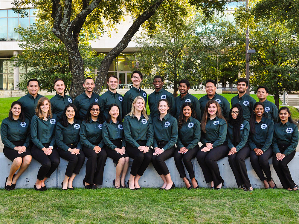 Student ambassadors sitting on the Davidson-Gundy Alumni Center lawn