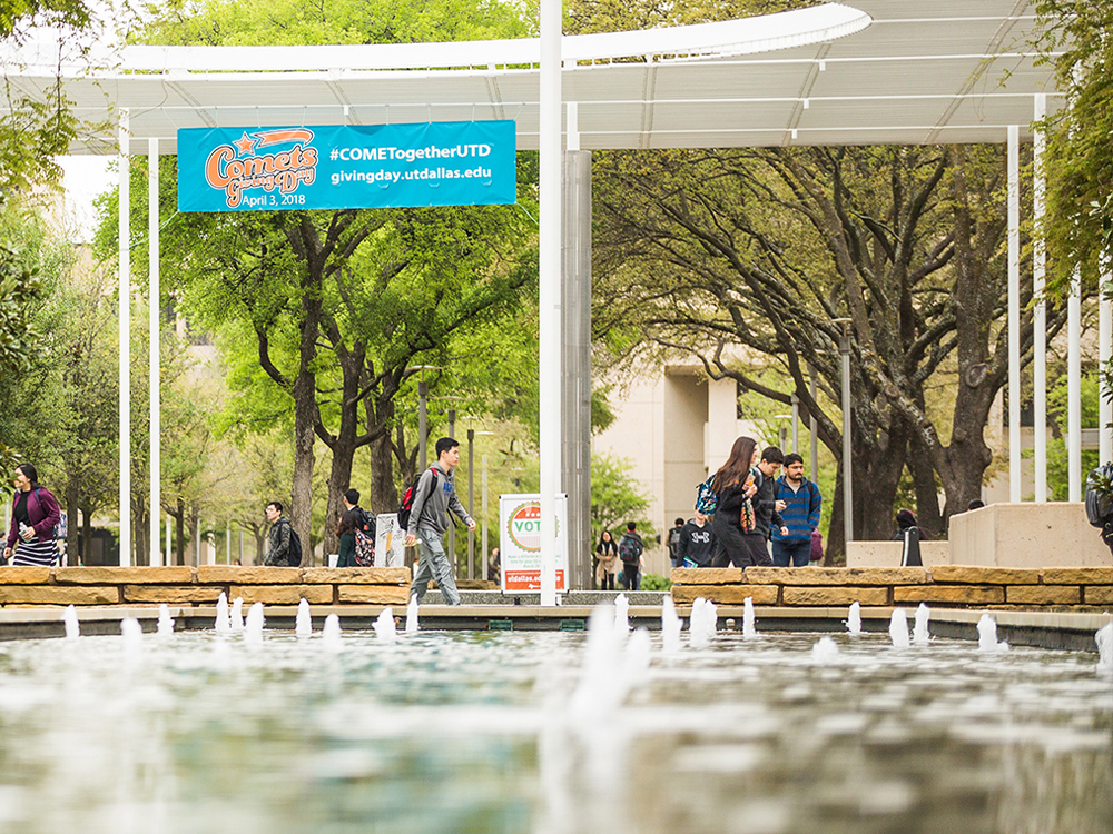 Students walking near reflecting pool