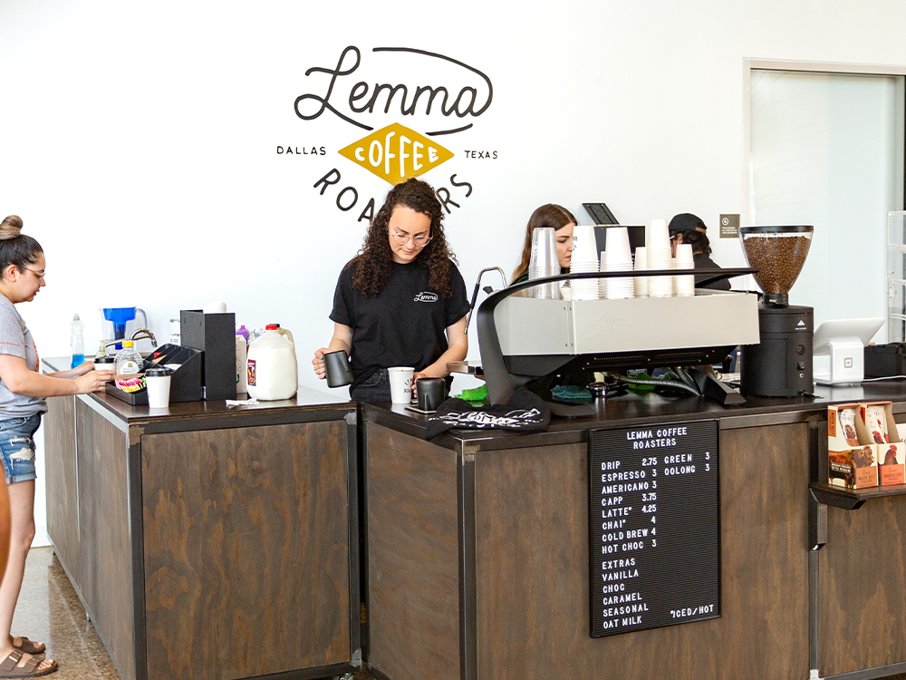 Working serving coffee at a business stand