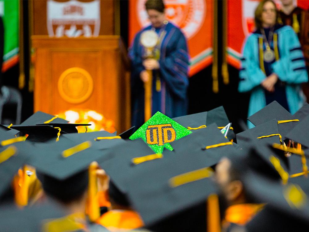 Graduation cap with the UTD monogram