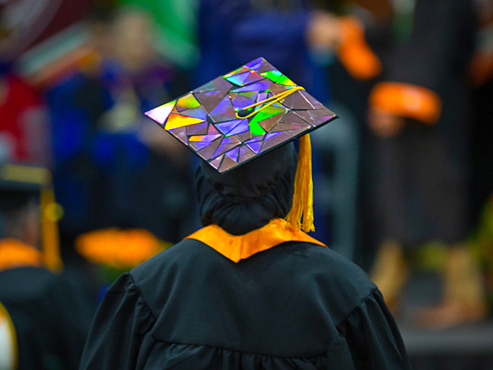 Graduation cap with reflective triangles