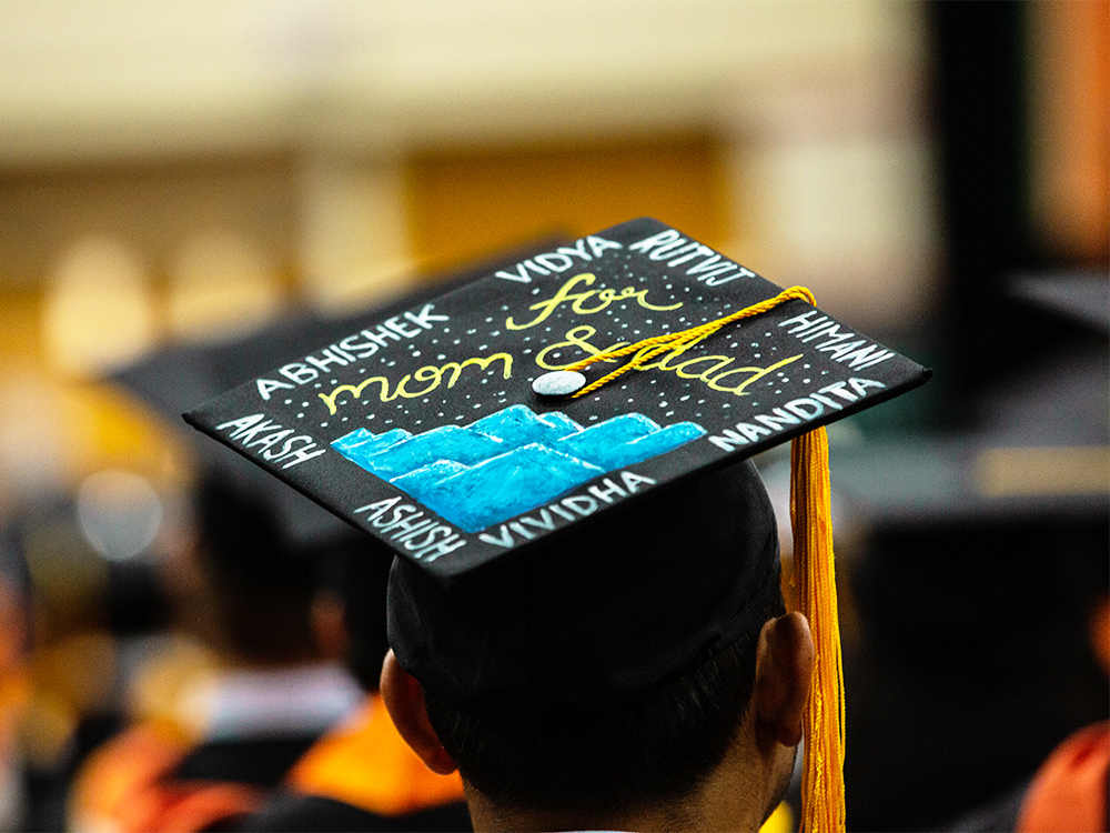 Graduation cap that reads for Mom and Dad