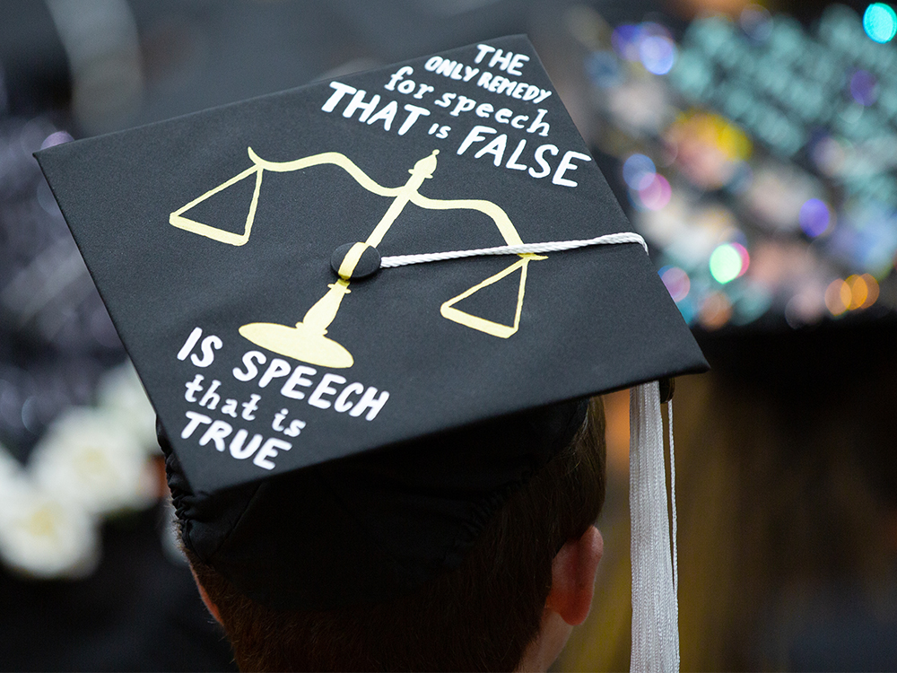 Graduation cap that reads the only remedy for speech that is false is speech that is true