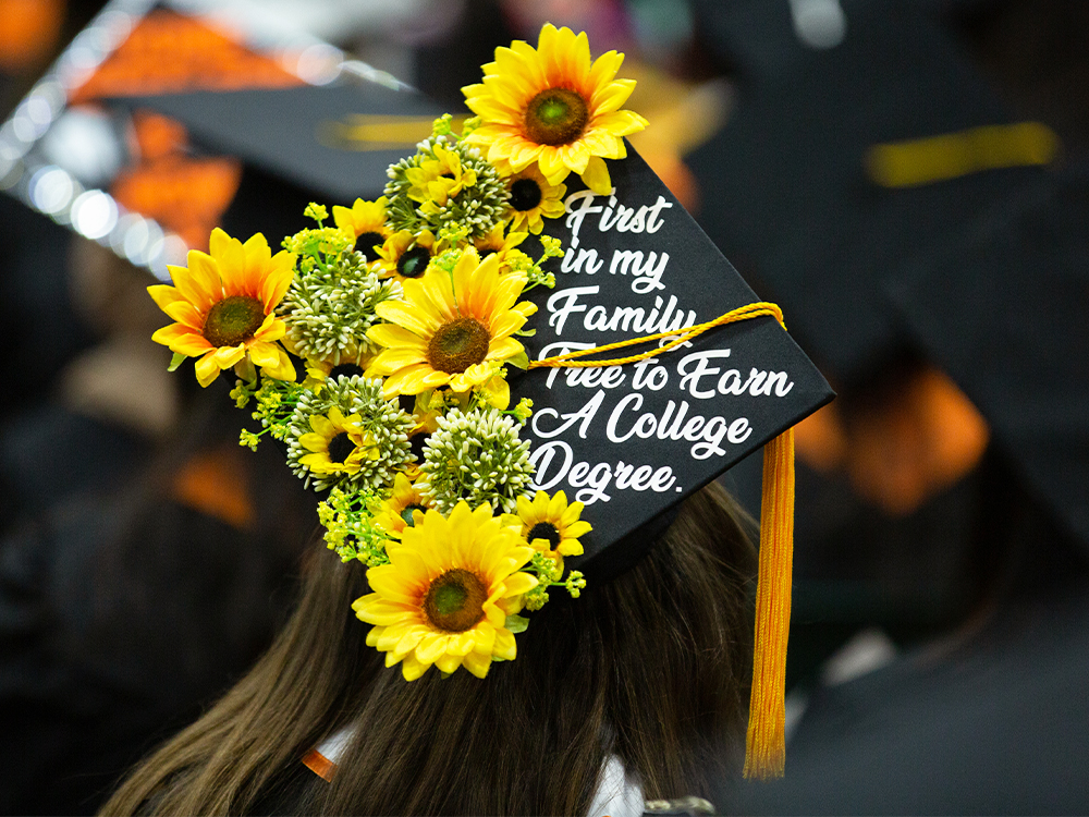 Graduation cap that reads first in my family tree to earn a college degree