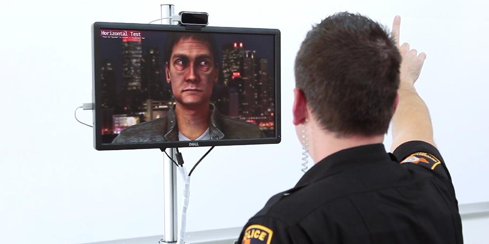 Officer using virtual DUI simulation