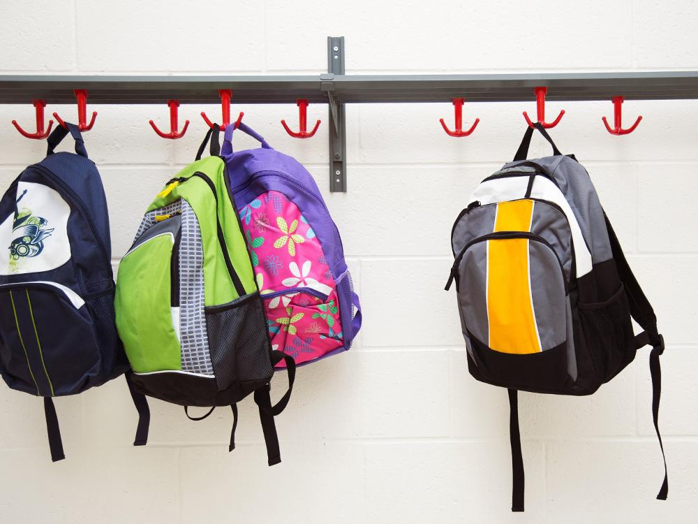 Backpacks hanging on hooks