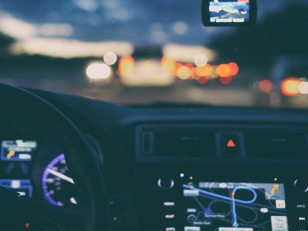 Inside of a car with gps at night
