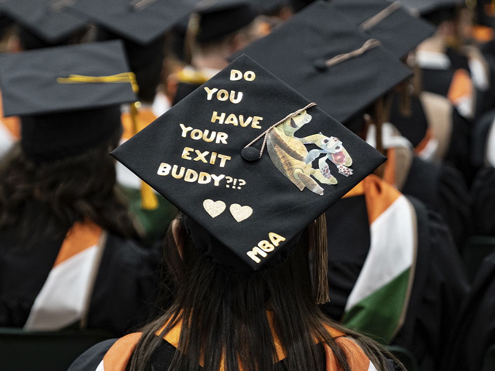 Woman wearing a cap that says do you have your exit buddy