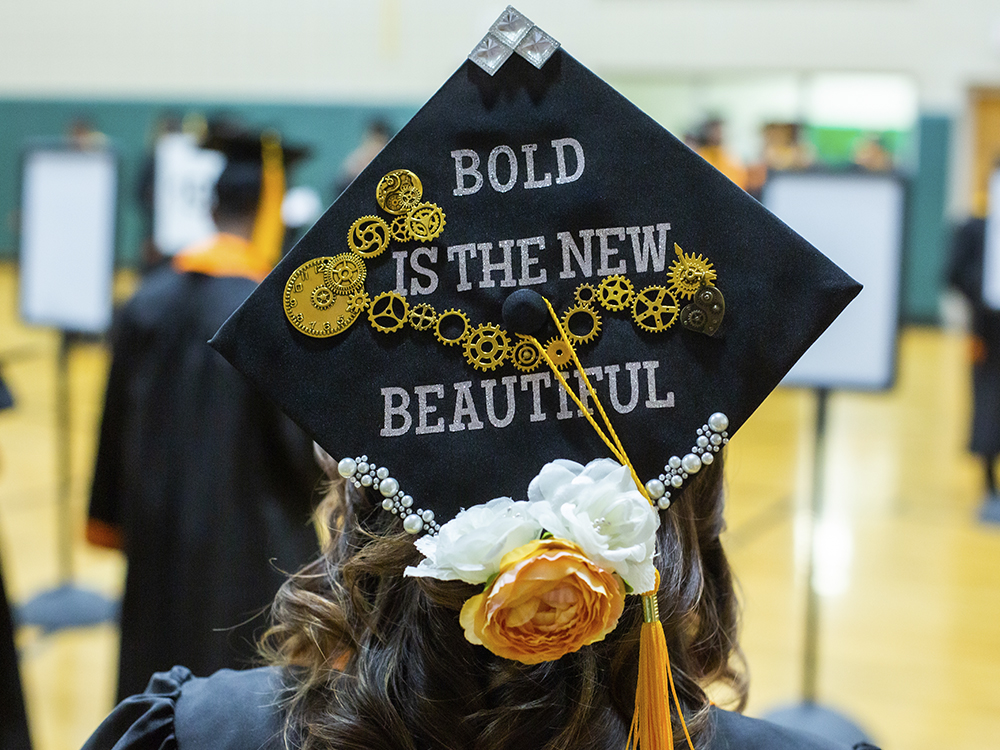 Woman wearing cap that says bold is the new beautiful