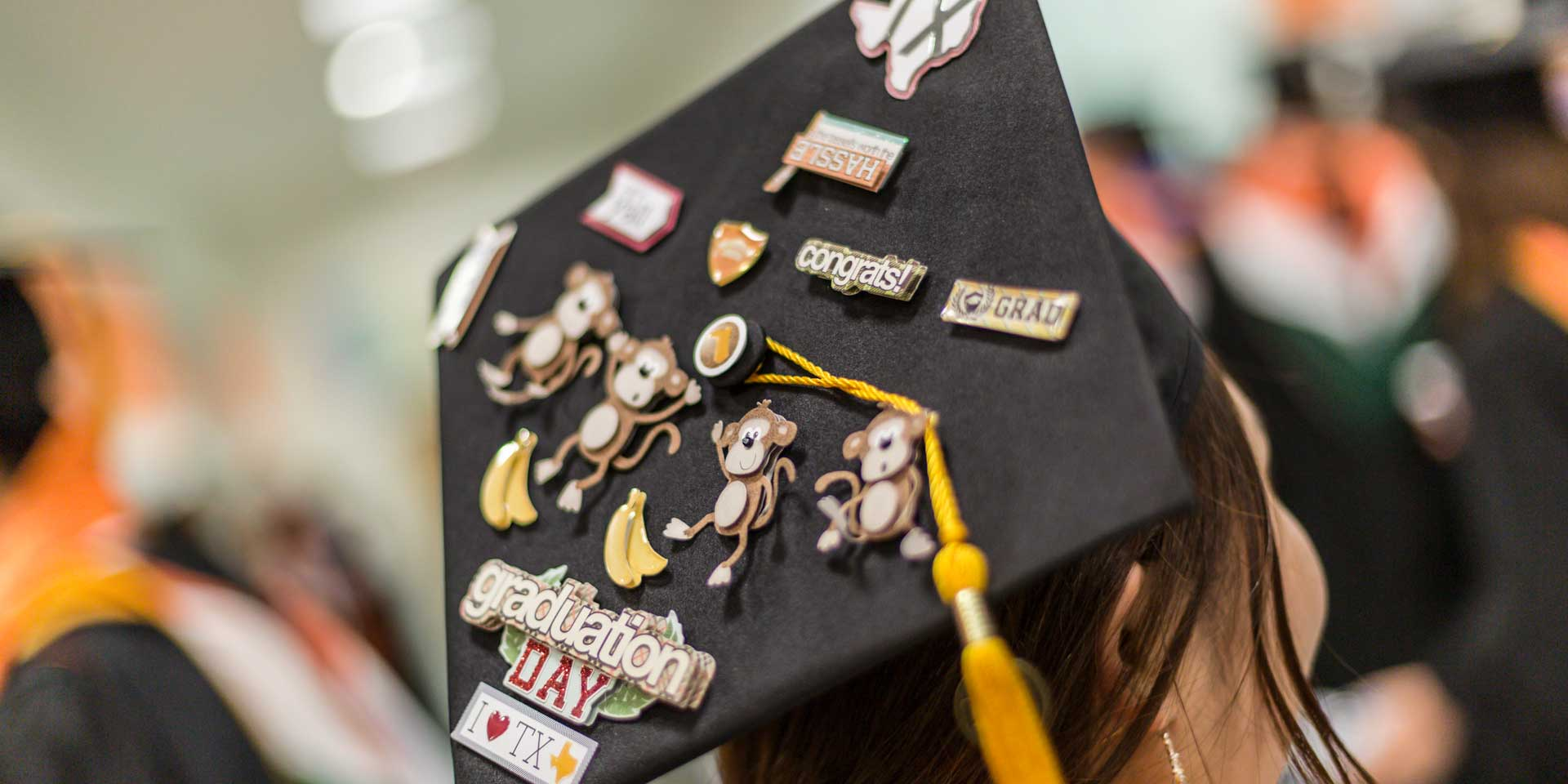 She earned a master's degree in finance and personalized her mortarboard with characters representing her birth during the Year of the Monkey and with Texas-themed decorations.